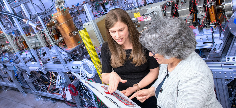 Lia Merminga and Lidija Kokaska at the PIP-II test stand at Fermilab.